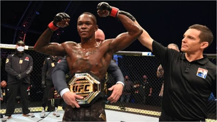 Nigeria's Adesanya retains UFC title, knocks out Costa in second round