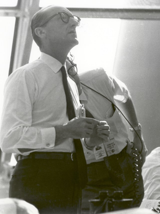 Dr. George E. Mueller, Associate Administrator for Manned Space Flight, NASA, follows the progress of the Apollo 11 mission. This photo was taken on July 16, 1969 in the Launch Control Center at the Spaceport on the morning of the launch.