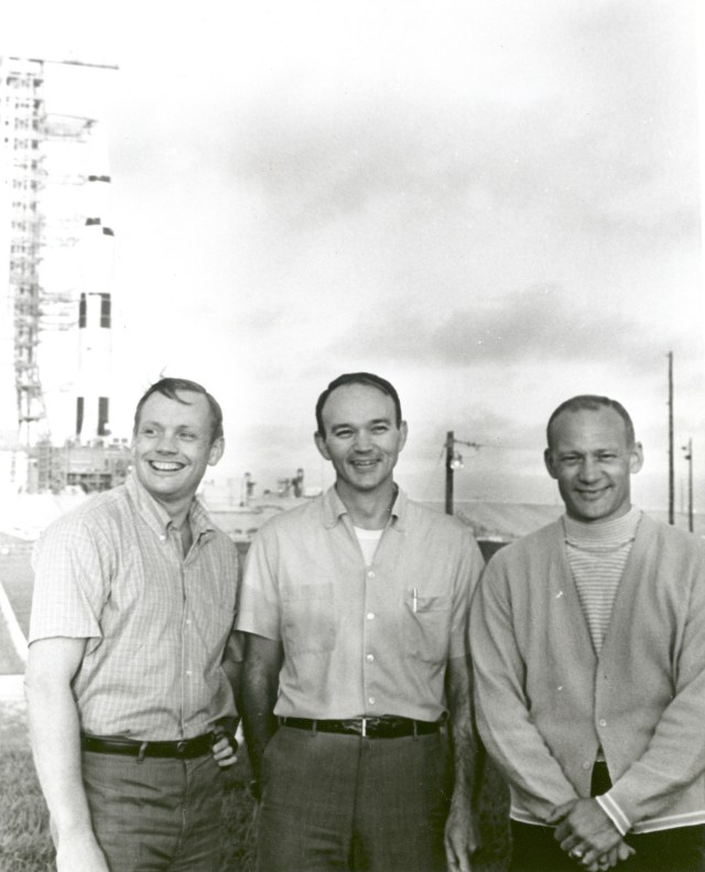 (May 20, 1969) NASA's Apollo 11 flight crew, Neil A. Armstrong, commander; Michael Collins, command module pilot; and Buzz Aldrin, lunar module pilot stand near the Apollo/Saturn V space vehicle that would eventually carry them into space on July 16, 1969.