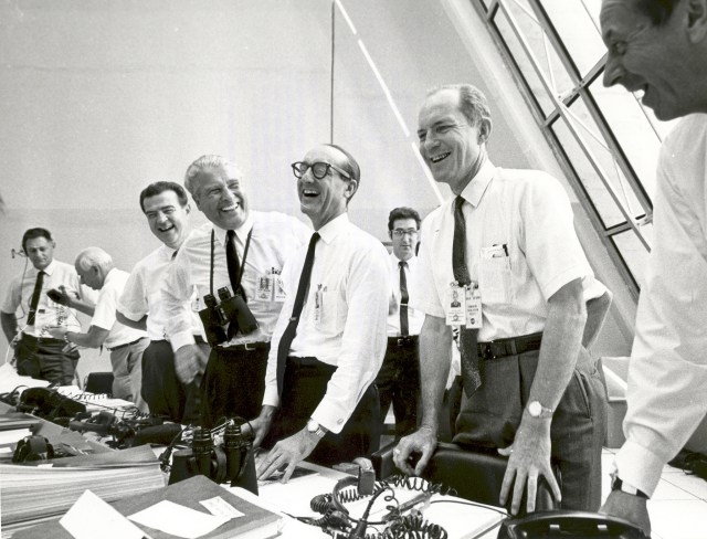 (July 16, 1969) Apollo 11 mission officials relax in the Launch Control Center following the successful Apollo 11 liftoff on July 16, 1969. From left to right are: Charles W. Mathews, Deputy Associate Administrator for Manned Space Flight; Dr. Wernher von Braun, Director of the Marshall Space Flight Center; George Mueller, Associate Administrator for the Office of Manned Space Flight; Lt. Gen. Samuel C. Phillips, Director of the Apollo Program