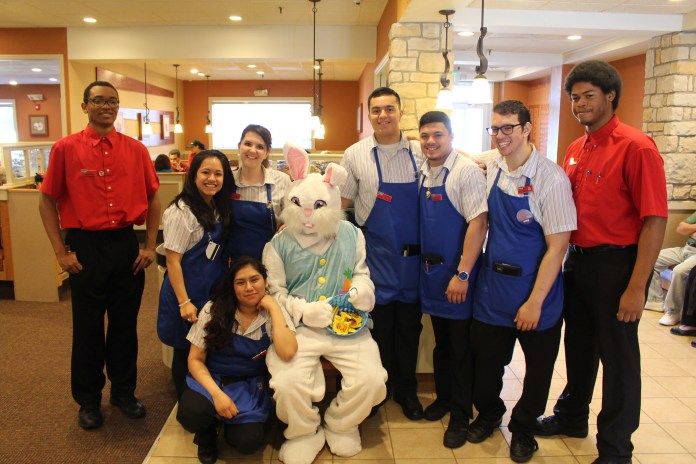 The staff at IHOP with the Easter Bunny