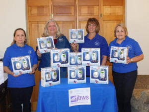 Woman's Club of Parsippany-Troy Hills members with the 12 baby monitors purchased with donations collected at the February General Meeting.  The baby monitors will be given to a local Jersey Battered Women's Services shelter.  From left – Lois Preis White, Joan Garbarino, Diana Freidinger and  Cathy Haney, Project Chairman.