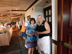 Club members Claudia McCarthy and Joan Garbarino were in charge of selling Tricky Tray tickets.