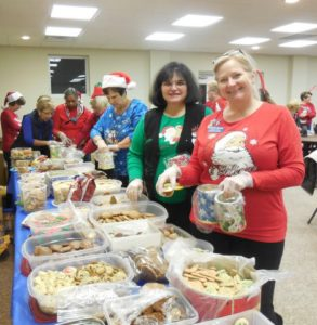 Club members baked over 20 kinds of cookies. In front - Jennifer Biondo, Teri Wohld and Kathy Roussel.