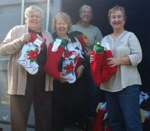 The storage container was filled with over 1200 stockings filled by the various clubs in NJ.  Fr left: Ora Kokol - Woman's Club of Woodstown, Barbara Cook -Suburban Woman's Club of Pompton Plains, Elaine Hossfield -GFWC Vernon Township Woman's Club and Bernadette Cicchino - Woman's Club of Parsippany Troy Hills