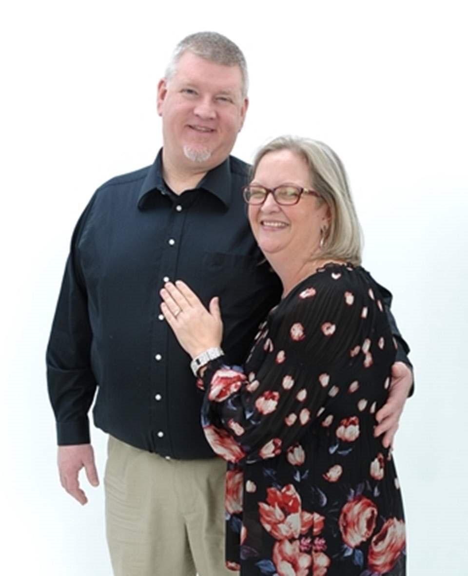 Photo of Steven & Deb Koster standing