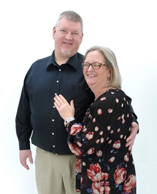 Photo of Steven & Deb Koster standing