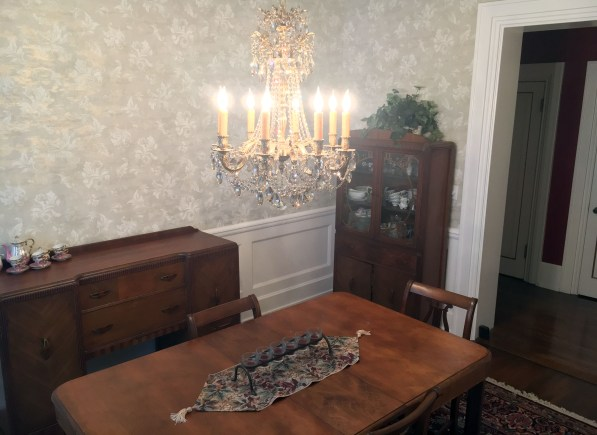 Dining room chandelier with table, buffet, and china cabinet