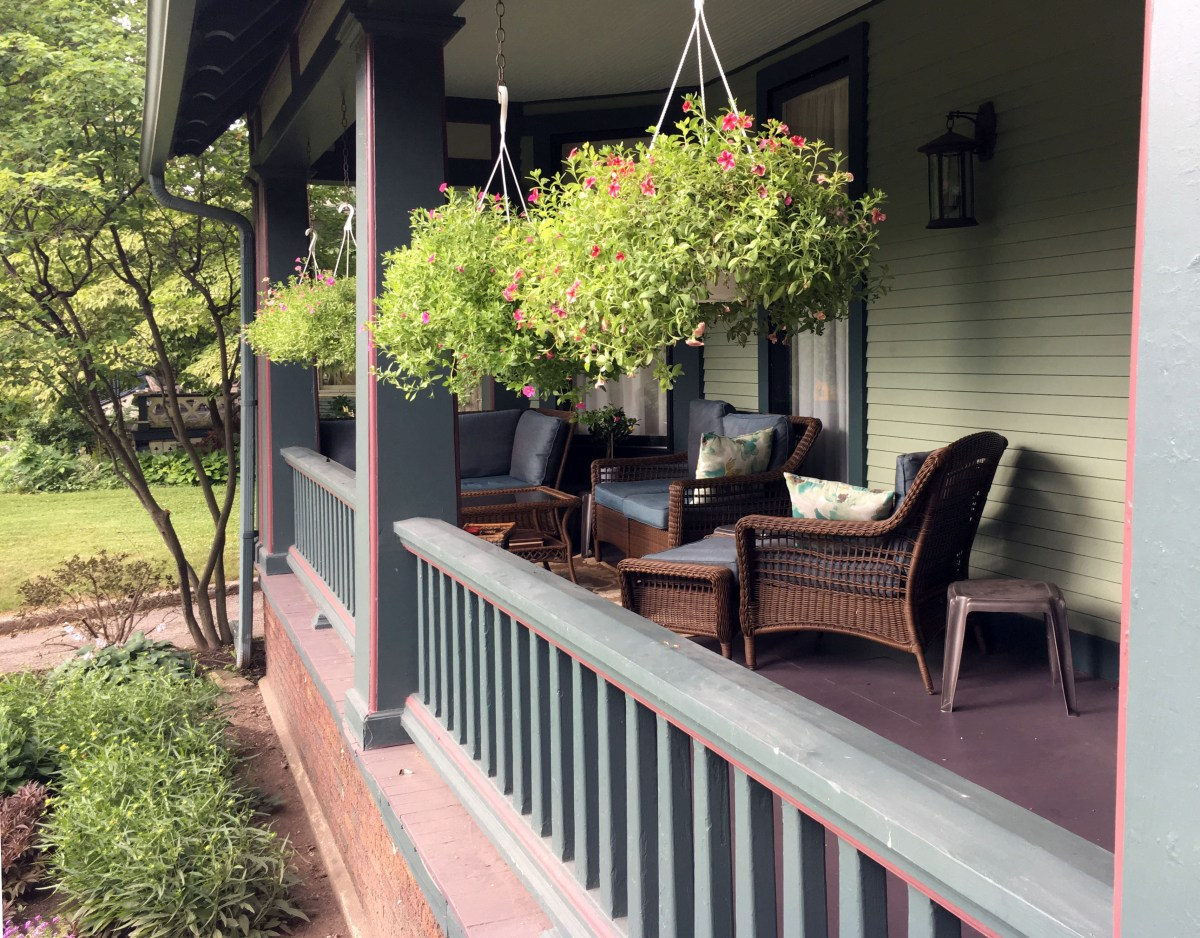 porch furniture and planters on the front porch