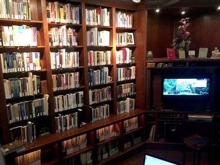 A wall of library books and a TV