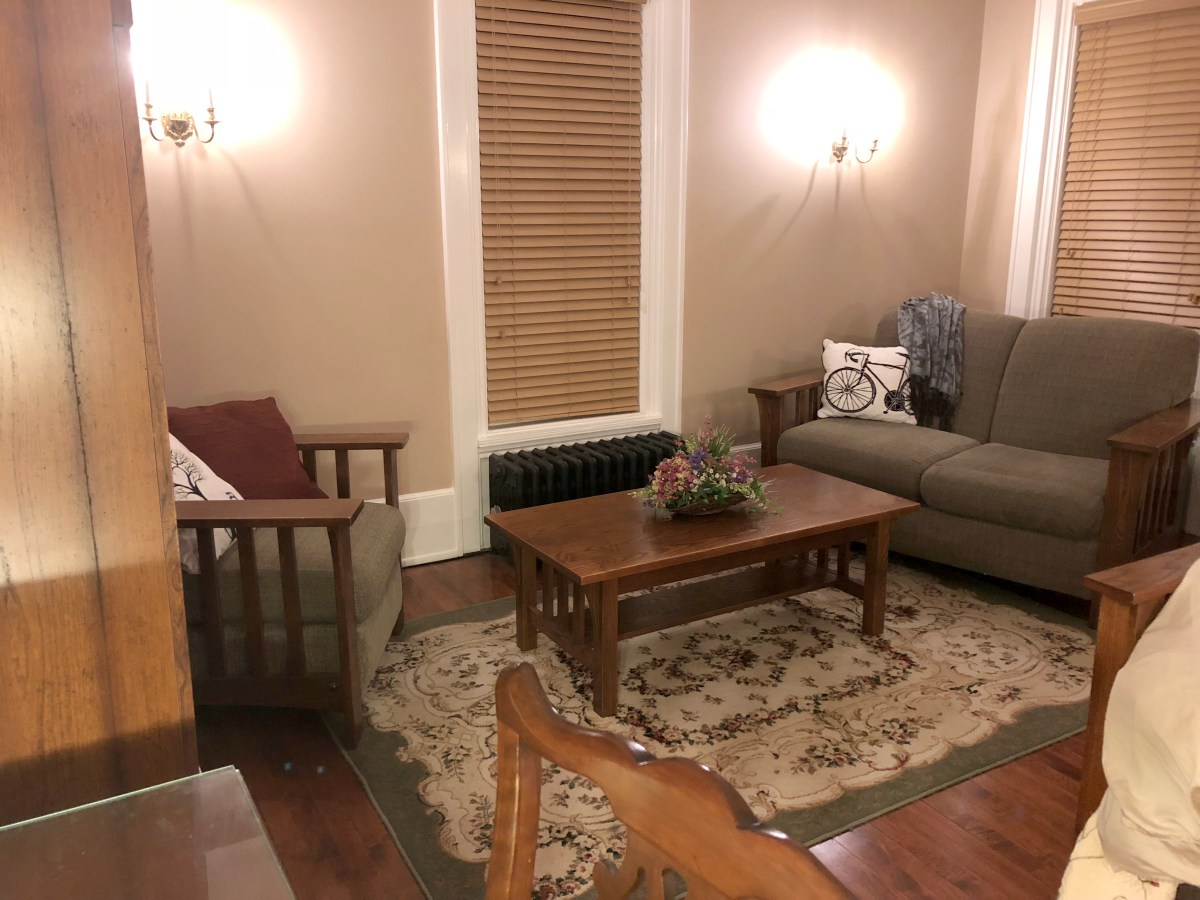 chair, coffee table and love seat in room 4