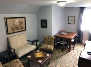 chairs, coffee table, and love seat with dining room table on third floor