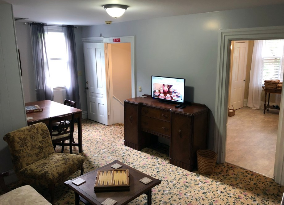 chairs, coffee table, and TV on the third floor