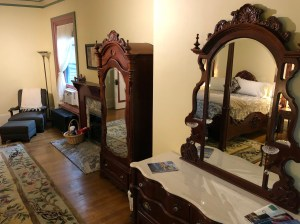 chair, fireplace, mirrored cabinet, and dresser