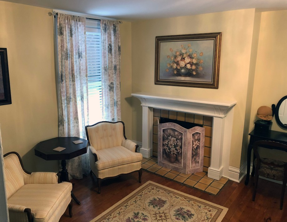 two chairs and a fireplace in Room 6