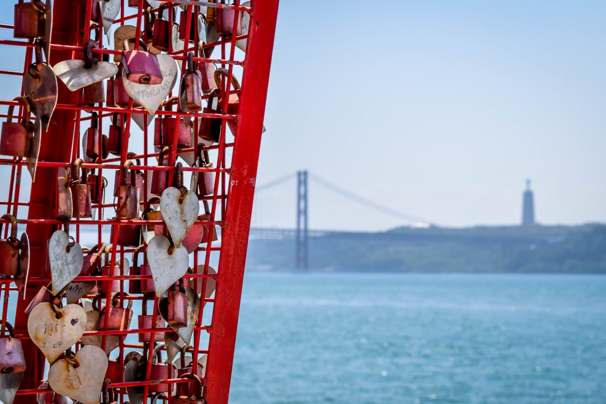 View of 25 de Abril Bridge from the Lisbon lovelock sign in Belem, Portugal