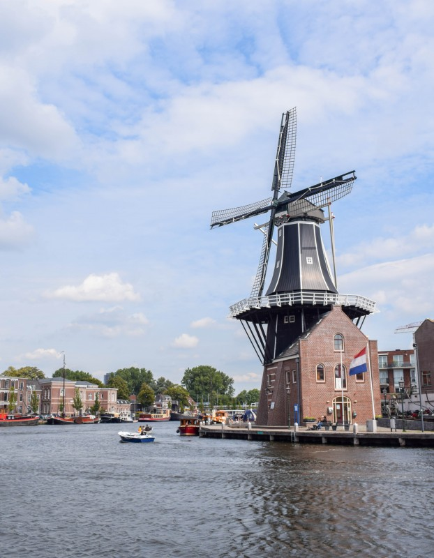 De Adriaan windmill from the river in Haarlem, the Netherlands