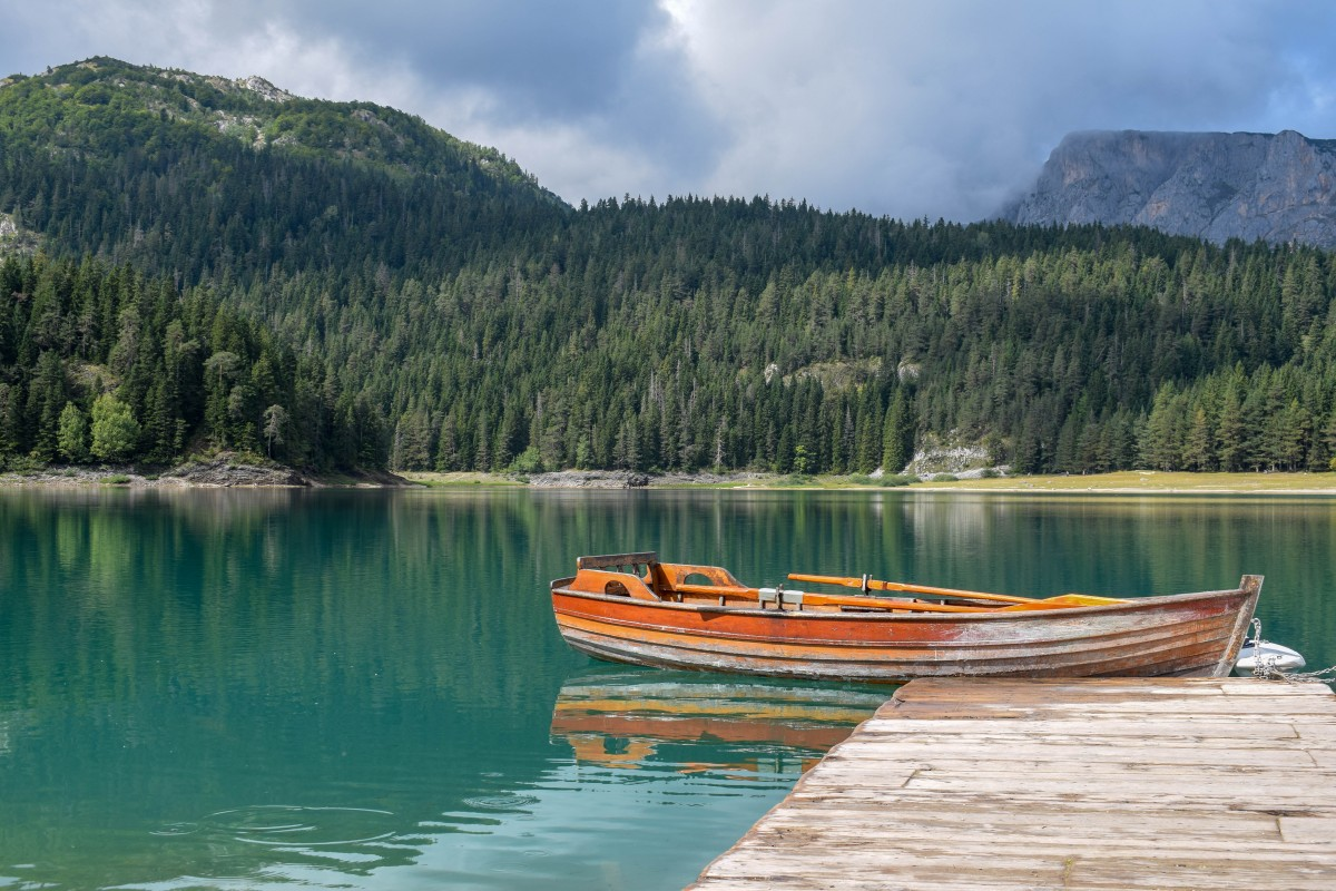 Canoe on Black Lake in Durmitor National Park Montenegro-how to travel more