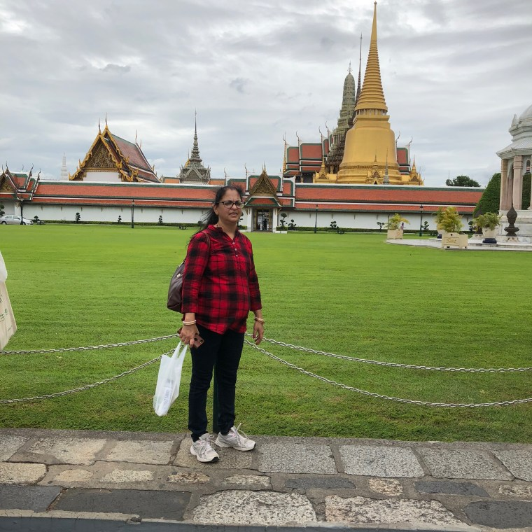 Deepshree posing with the Grand Palace in the background