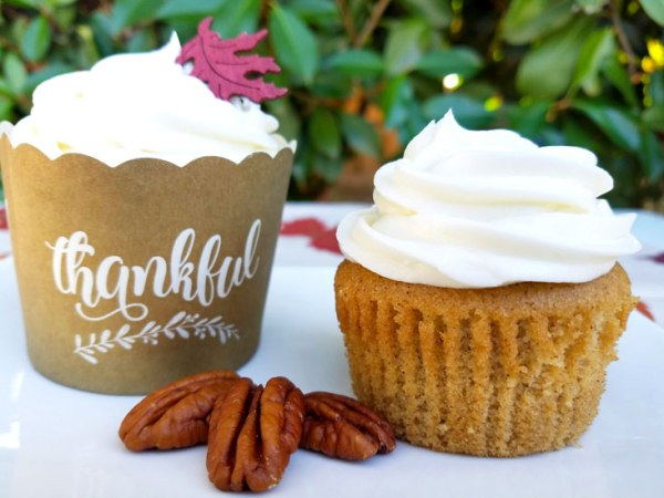 These Spice Cupcakes with Maple Pecan Cream Cheese Icing are divine and your Thanksgiving or fall party guests will agree! This homemade, easy fall cupcake can be topped with a liqueur infused icing or a kid friendly icing - find both in this recipe. #Thanksgiving #Thanksgivingrecipes #fallrecipes #holidaybaking #holidayrecipes #cupcakes