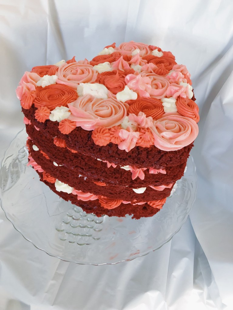 Need a last minute Valentine's Day gift idea for someone who loves to eat? I've got the perfect idea! This easy DIY Valentine's Day cake is delicious and beautiful. Decorate this cake for him and he'll be swooning!