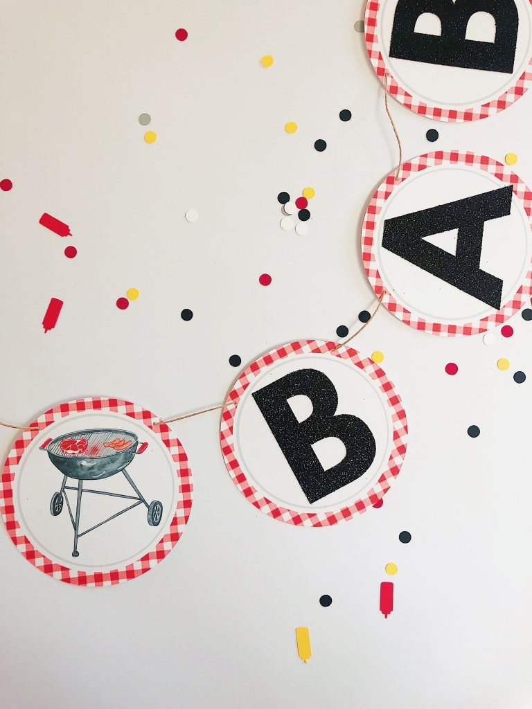 "Fire up the grill, mow the back yard, put out some decorations, and throw that apron on (Bonus points if it says ""Kiss the Cook""). It's time for a BBQ! and by that, I mean a bbq themed baby shower. Whether you're serving hot dogs or burgers and beer, this post has you covered. After you are finished reading you'll be able to host the perfect baby BBQ themed baby shower - no venue rental required. Whether you're serving hot dogs or burgers and beer, this post has you covered. After you are finished reading you'll be able to host the perfect baby BBQ themed baby shower - no venue rental required."