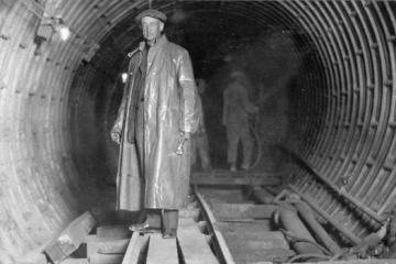 Denver Water Manager Hiram Hilts inside the under-construction Moffat Tunnel. Image courtesy Denver Water.