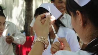 4.25 - Champasack - prov. 1 launch - nurse filling syringe - gold bangles 900 pixels