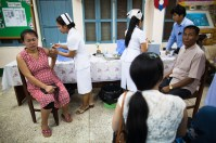 4.23 - Vientiane - MCH - UPS - woman being vaccinated (closed eyes)