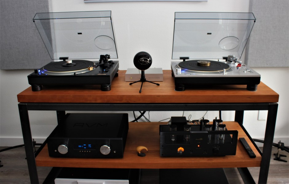 two turntables and a microphone