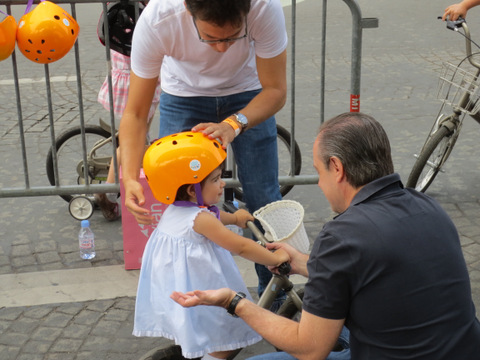 A toddler is fitted for her helmet