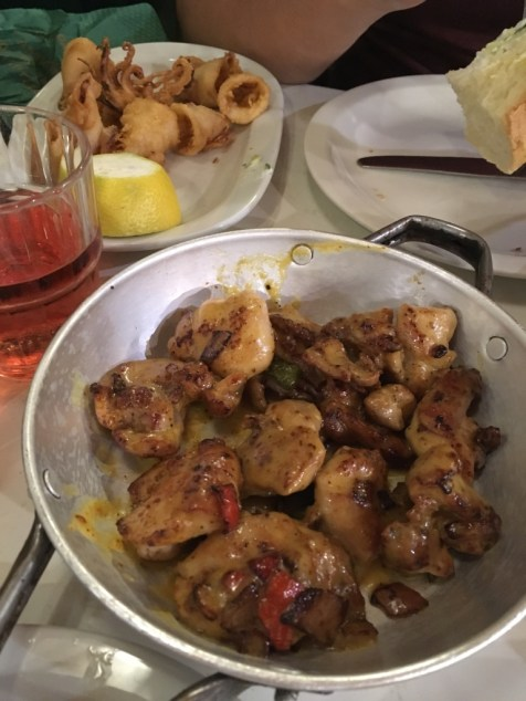 Fried calamari and chicken in a lemon mustard sauce
