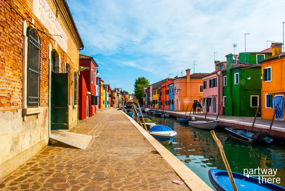 Many Colorful houses along the canal in Burano, Italy