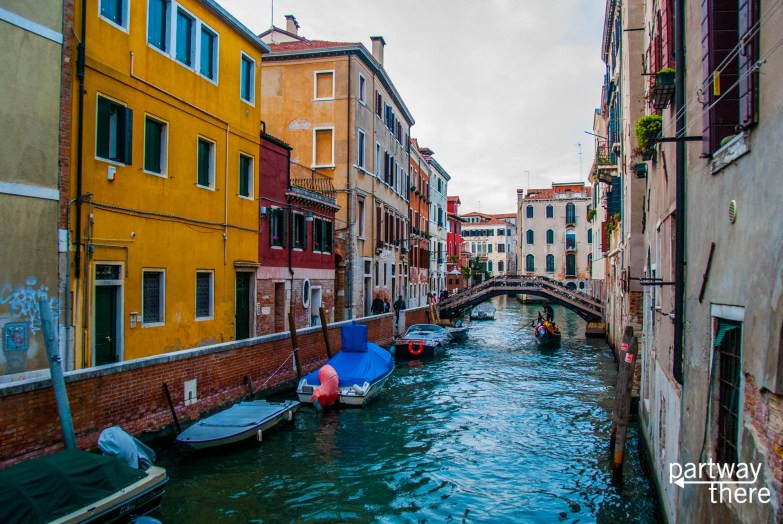 Small canal with gondola in Venice