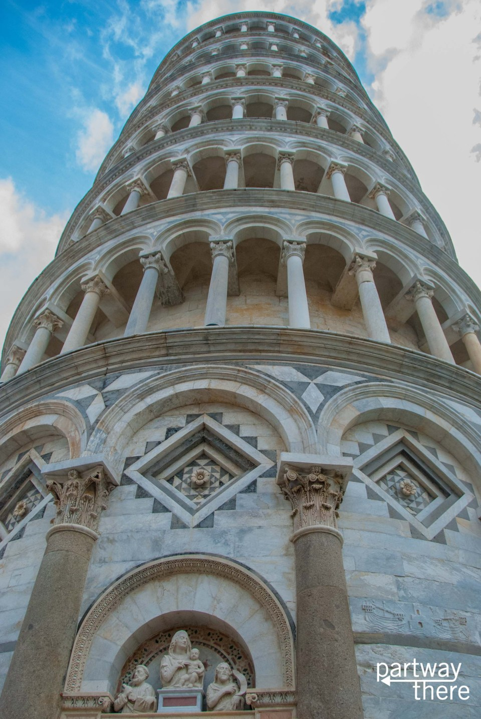 Close-up looking up of leaning tower of Pisa