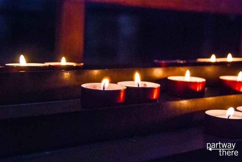 Candles lit in prayer in Siena Cathedral