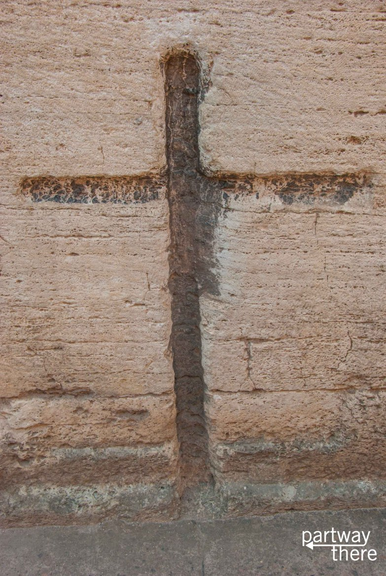 A cross carved into the wall of the Colosseum in Rome, Italy