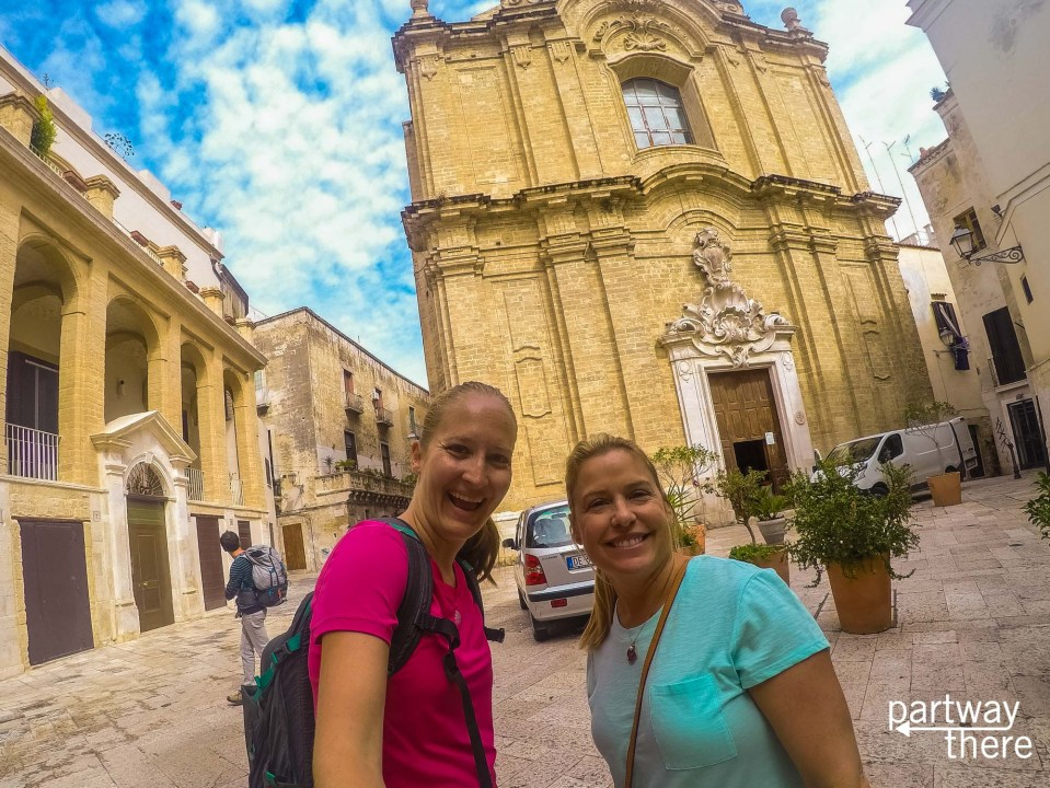 Friends outside church in Bari, Italy, inside the Old Town