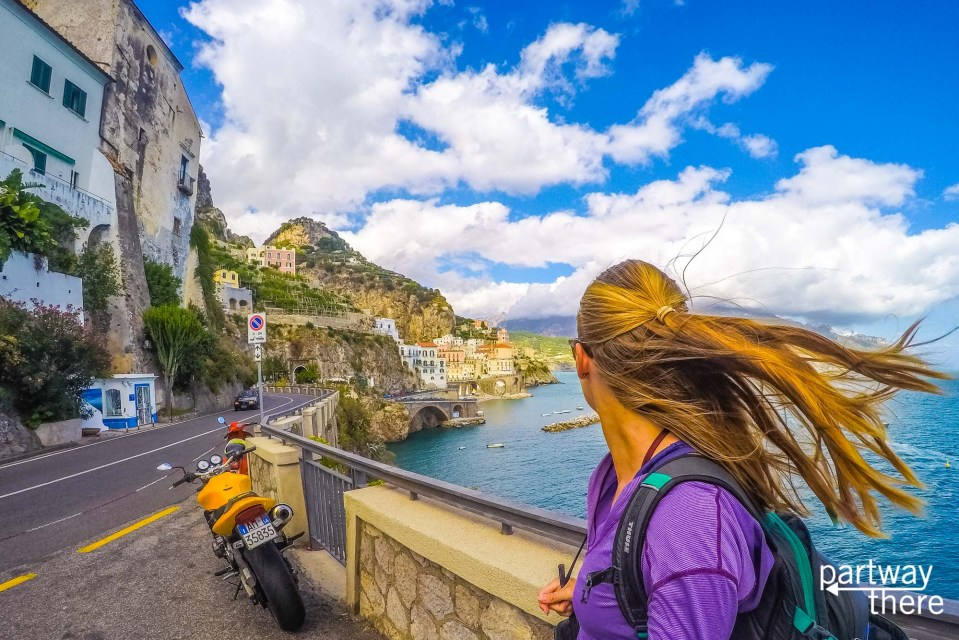 Amanda Plewes next to a road looking over Amalfi