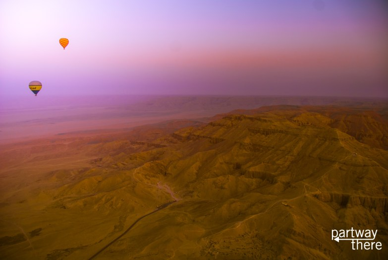 Sunrise hot air balloon over the Valley of the Kings in Luxor, Egypt