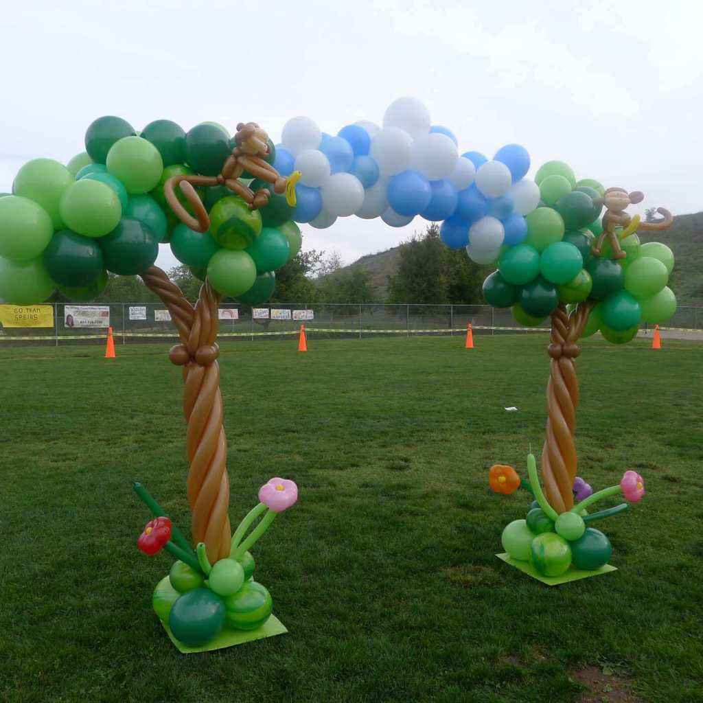 Sculptured tree balloon arch with monkey detail, jog-a-thon