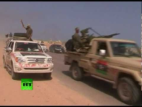 Action-video-of-Libya-fighting-rebels-retreat-after-Gaddafi-forces-fire
