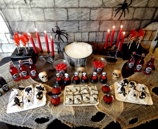 this skull themed halloween party is perfect for kids who are too old for cutesy holiday decor but not old enough to go all out with the scary stuff