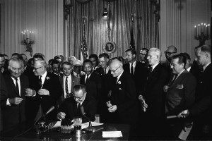 Lyndon Johnson signing Civil Rights Act