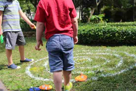 Bean bag toss game using spray chalk