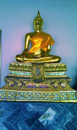 Bedazzled golden buddha in Wat Pho in Bangkok
