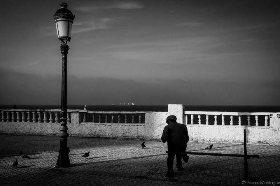 The Algerian man and the sea. Alger, Algeria. Pascal Montagne for Hans Lucas #travel #algerie #algeria #alger #bnwphotography #bnw #blackandwhitephotography #sonyrx100 #blackandwhite #sea #boat #man #oldman #sun #shadows #seashore #instagood #instalike #instadaily #dailypic @algerie.aujourdhui @algerievuedenbas @algerie_tourisme