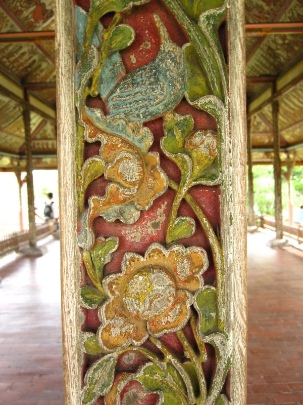Carved, wooden pillar
