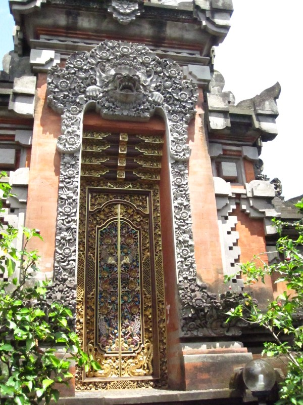 A well-decorated doorway at our hotel, Agung Cottages.