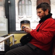 Texting in red  by Paula Jarrin barcelona, bus, colors, igerbcn, igerscatalunya, instagramers, iphoneonly, iphonesia, man, passengers, red, snapseed, streetphotography, ubiquography,